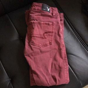 Denim - American eagle burgundy skinny jeans